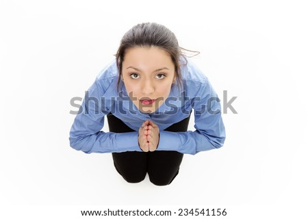 woman praying on her kneels shot from a birds eye view looking down - stock photo
