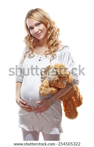 woman pregnant on white background with toy