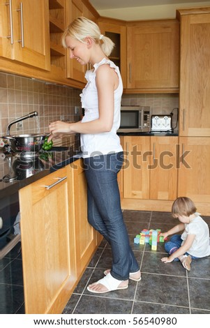 Woman preparing food in he kitchen - stock photo