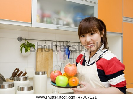 woman preparing food in her kitchen. - stock photo