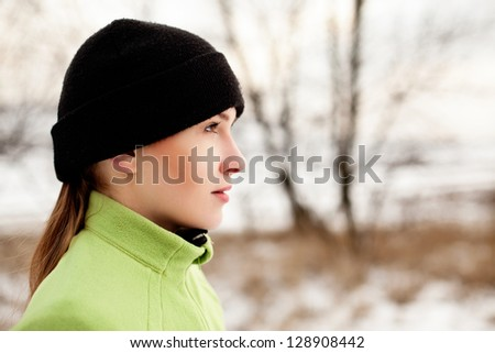 Woman preparing to run in winter