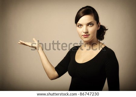 woman presenting something imaginary with her right hand, vintage colors