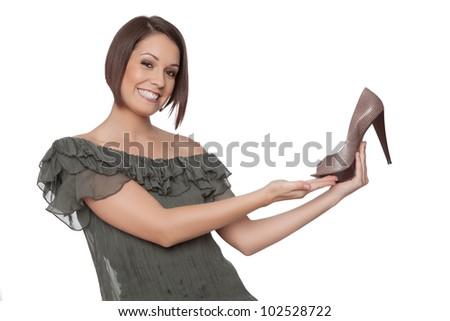 Woman presents a shoe - stock photo