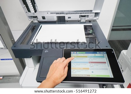 woman press set up printer before scanning business documents