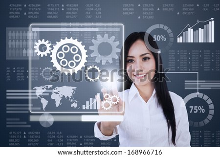 Woman pressing a gear on a touch screen interface - stock photo