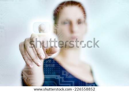 Woman pressing a touch panel - stock photo