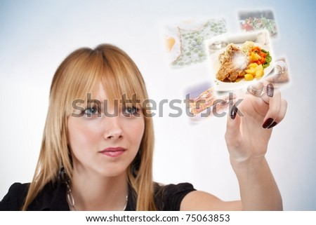 woman pressing a touchscreen button, with food selection - stock photo