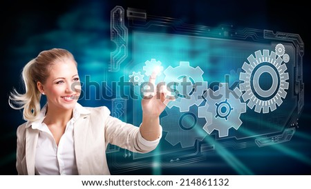woman pressing a virtual interface to control a system  - stock photo