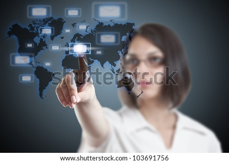 Woman pressing mail button on a virtual screen - stock photo