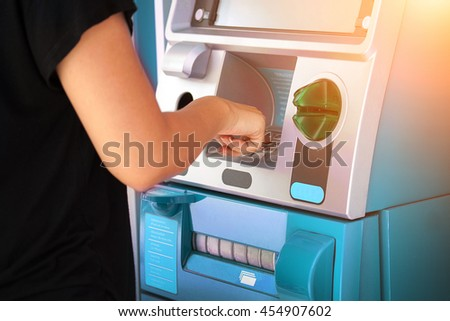 Woman pressing password number on blue ATM machine - Online banking business concept. - stock photo