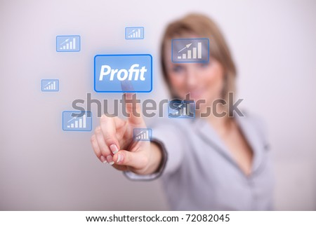 Woman pressing profit button with one hand - stock photo