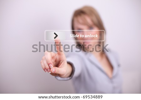 Woman pressing slide to unclock button with one hand