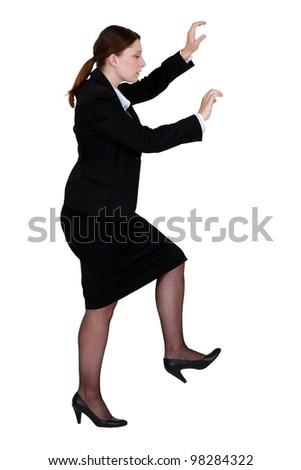 Woman pretending to climb - stock photo