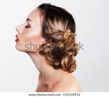 Woman profile portrait in studio - stock photo