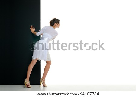 Woman pull black billboard on empty white backgrounds. This is not isolated - stock photo
