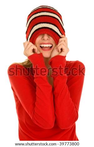 Woman pulling down woolen hat - stock photo