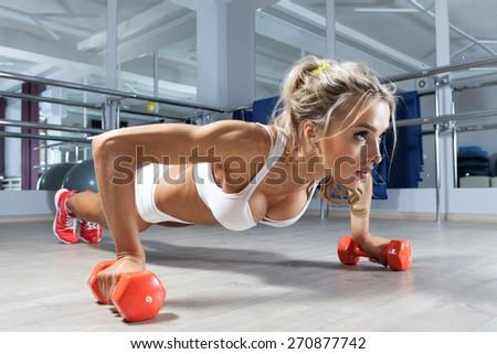 Woman push-ups on the floor - stock photo