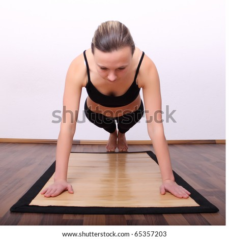 Woman pushed on the floor in the room - stock photo