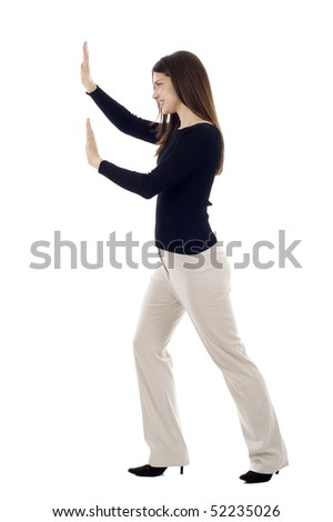 Woman pushing an imaginary object isolated over a white background - stock photo