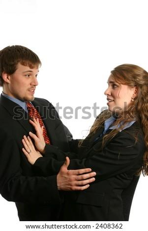 Woman pushing man away - stock photo