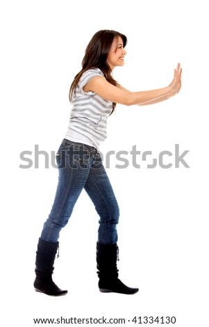 woman pushing something imaginary isolated over a white background