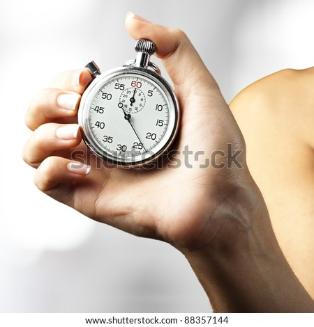 woman pushing stopwatch button indoor