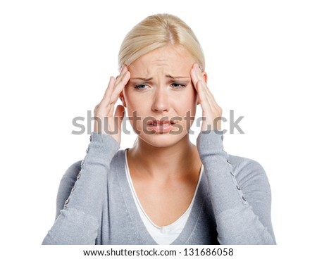 Woman puts hands on the head, isolated on white. Concept of problems and headache