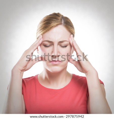 Woman puts hands on the head, toned photo.. Concept of problems and headache. - stock photo