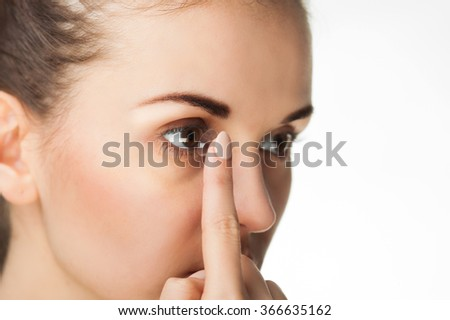 Woman putting contact lens in her eye concept of healthcare