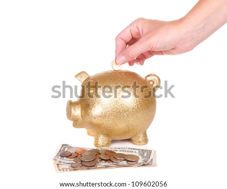 woman putting money in piggy bank, on white - stock photo