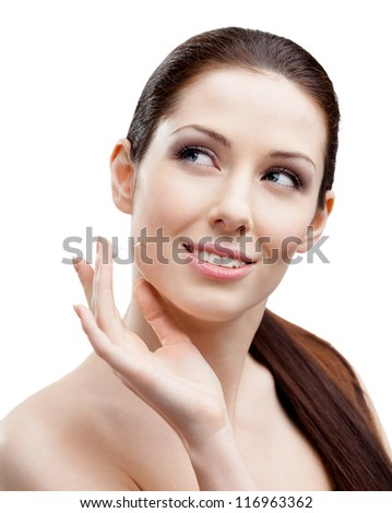 Woman putting on face cream to have smooth perfect skin, isolated on white - stock photo
