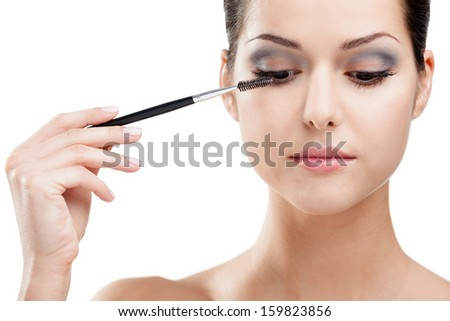 Woman putting on make up with cosmetic brush, isolated on white. Beauty procedures - stock photo