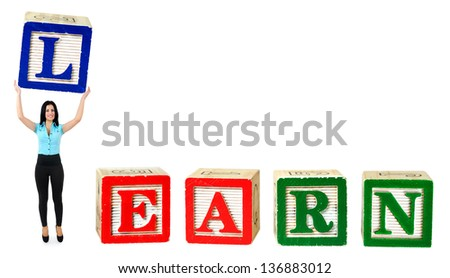 Woman raise letter from word Learn - stock photo