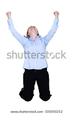 Woman raised hands in delight - stock photo
