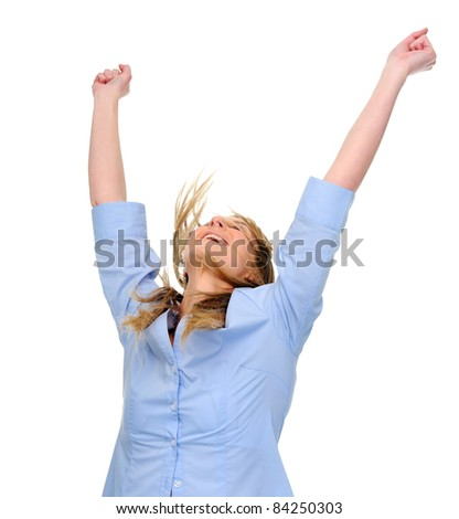 Woman raises her arms overhead in joy - stock photo