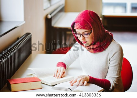 Woman read book sitting at the table