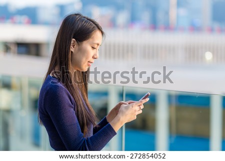 Woman read the message on cellphone - stock photo