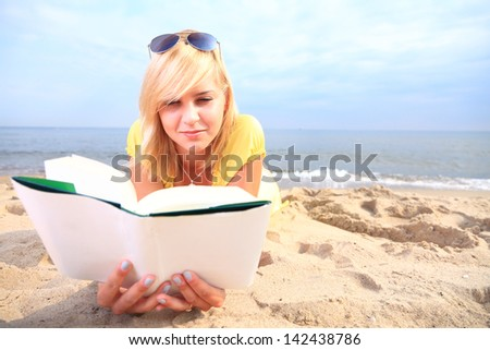 woman reading a book girl the yellow dress water beach