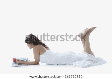 Woman reading a magazine - stock photo