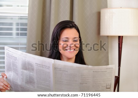 Woman reading a newspaper - stock photo