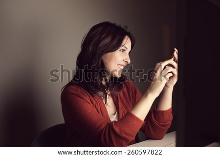 Woman reading and writing instant messages
