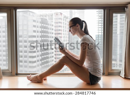 Woman reading book in the city. - stock photo