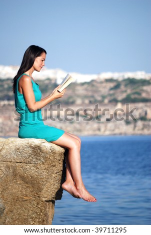 Woman reading by the sea