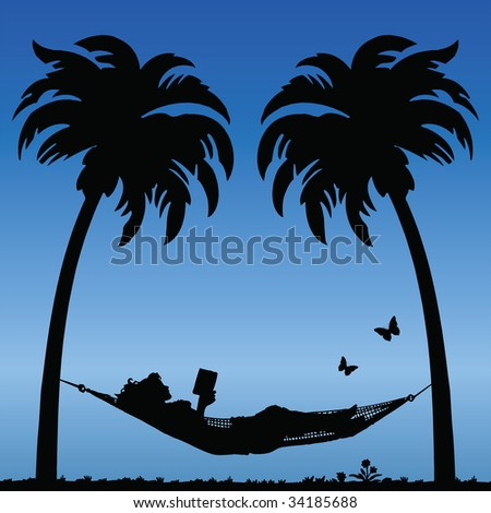 Woman Reading in a Hammock Between Palm Tress - stock photo