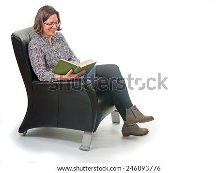 Woman reading in the armchair isolated on white background - stock photo