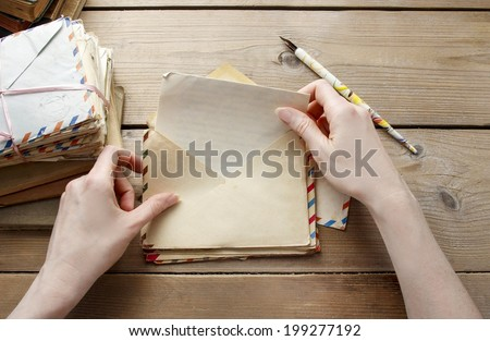 Woman reading letter from the past - stock photo