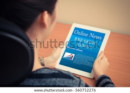 woman reading online news with digital tablet - stock photo