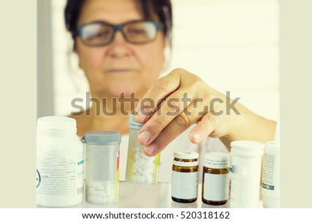 Woman reading prescription bottle