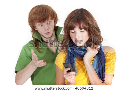 woman reading sms - surprised man looking over shoulder - stock photo