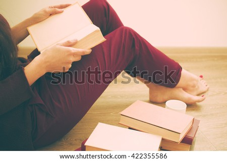 Woman reading the book - stock photo